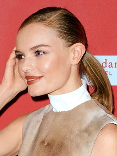 Sleekly Parted ponytail on Kate Bosworth. 9 New Ponytails to Try This Summer: Hair Ideas: allure.com