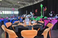 "Attendees of the Harbor History Museum's ""History Rocks"" dinner and auction were blasted back in time into the 1980s. We at the museum like the bright colors of the chairs and decorations to fit the theme. It certainly brings one back to the days of the ""Brat Pack,"" padded shoulders and big hair."