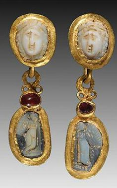 Cameo, garnet and gold earrings. With a cameo of a facing female on the upper section of each and suspending a gold pendant with cameos of Eros figures; adorned with garnets. Roman Jewelry, Jewelry Art, Gold Jewelry, Jewelery, Jewelry Accessories, Jewellery Box, Cameo Jewelry, Jewellery Shops, Rhinestone Jewelry