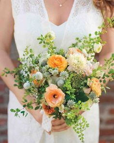 Maidenhair ferns, small-leaved spirea, and Queen Anne's lace surrounded rose geraniums, ranunculus, gomphrena, astrantia, and snapdragons in this bride's bouquet.