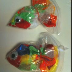 Tissue paper fish. Made with sandwich bags, an elastic band and a googly eye.