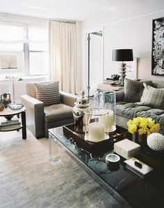 Living Room Photo - Coffee table styling with trays and accessories ... love this style ...