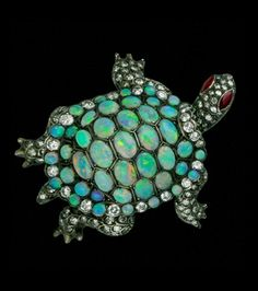 Antique Turtle brooch with an Opal and diamond body and Ruby eyes
