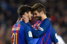 Barcelona's Portuguese midfielder Andre Gomes (L) celebrates with Barcelona's defender Gerard Pique (R) after scoring a goal during the Spanish league football match FC Barcelona vs Valencia CF at the Camp Nou stadium in Barcelona on March 19, 2017. / AFP PHOTO / LLUIS GENE