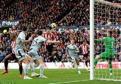 Sunderland striker Connor Wickham loses his man to head home his team's first goal against Burnley