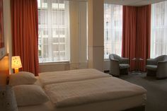 The 3-star Rho hotel is  close to the Central station.  The rooms are modern and comfortable.  http://www.rhohotel.com/index.html