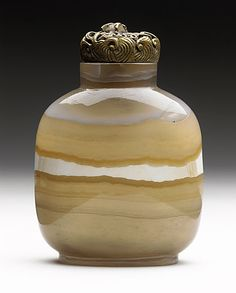 Chinese Snuff Bottle (Biyanhu)  ~  middle to late Qing dynasty, about 1700-1911, Carved banded agate, with reticulated metal stopper.