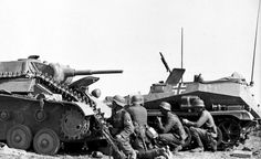 German troops take cover behind a knocked out T-70 light tank, summer 1942