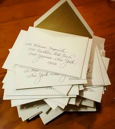 My fancy script on Vera Wang envelopes with gold liners {Calligraphy by Carrie}