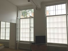Bottom up roller blinds and blackout roller blinds installed to large windows | Kentish Town, London | Made to measure | Made in the UK | Double blinds