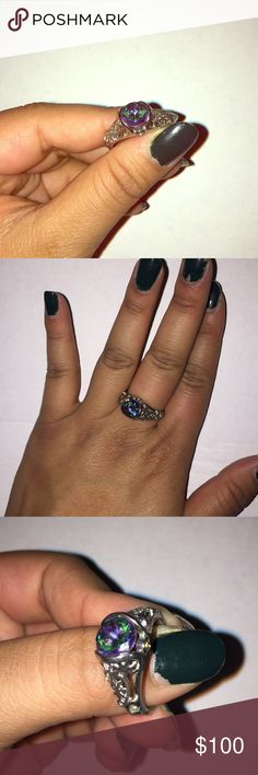 Vintage silver rainbow topaz ring 💍 Gorgeous sterling silver 925 stamped mystic topaz ring with floral detail and two stones on the side. I would say it is size 7 or 8. Kay Jewelers Jewelry Rings