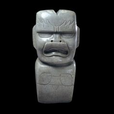 The Olmec fashioned votive axes in the form of figures carved from jade, jadeite, serpentine and other greenstones. The figures have a large head and a small, stocky body that narrows into a blade shape. They combine features of a human and other animals, such as jaguar, eagle or toad. The mouth is slightly opened, with a flaring upper lip and the corners turned down.