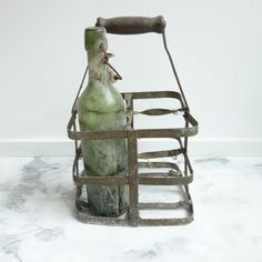 This is a simple but beautiful French vintage bottle holder — perfect for toting flowers, wine, and more to your table. French Industrial Decor, Flowers Wine, Decoration Piece, Vintage Bottles, Antique Clocks, Bottle Holders, French Vintage, Cool Kitchens, Pottery Barn
