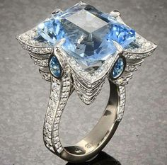 Beautiful blue stone unique 1920 flare ring. Not sure if topaz or sapphire. This is so pretty!