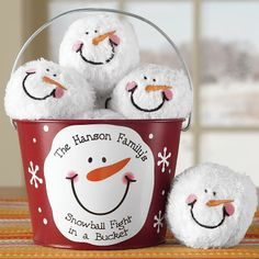 Terrific idea for a child in a no snow zone! Snowball Fight In A Bucket. Hand sew face onto a washcloth or fabric. Then stuff and add some beads or other items for some throwing weight. Paint snowflakes & snowman face, plus personalize with the child's name. Cool! DLW