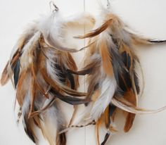 All natural brown and white feather earrings. Visit my shop to see more!! #teampinterest