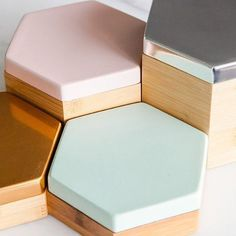 These fun Hex #Boxes designed by @eviegroup will keep your special wares safe, with its felt-lined #bamboo container and pastel aluminum lids. Stack and display them proudly on your desk, coffee table, or bedside table.