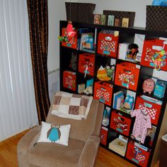 Baby organization- bookshelf IKEA, milk crates the container store