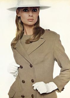 Jean Shrimpton wearing a double-breasted coat by Susan Small and hat by Herbert Johnson. Photographed by Mary Evans, 1965
