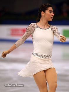 An easy-to-make, simple raglan-sleeved dress like Jalie 2104 (http://www.jalie.com/jalie2104-raglan-sleeved-skating-dress.html)