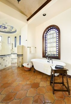 Spanish Style Bathroom.  Note the antique basket for towels and the (tile top?) table.