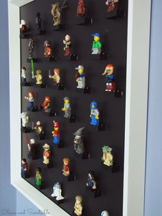 Keep your child's Lego collection under control by attaching figures to magnetic Lego blocks and hanging them from the back of a picture frame.