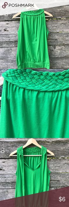 Vintage Look Braided Green Tank Top Vintage look braided green tank top with tie on top and cuffed bottom.  Top to bottom of shirt measures about 25 to 26 inches, bottom of under arm to bottom of shirt measures about 18 inches, underarm to underarm across the shirt measures about 18 inches.  Cotton blend stretchy material.  Could be worn with the tie in the front or the tie in the back. Vintage Tops Tank Tops