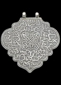 Silver 'Derwish pendant'. Late-Ottoman, ca. 18th-19th century. From Central Anatolia, probably from the Bektaşı Order. Featuring calligraphic inscriptions with Nad-e-Ali ( a protective prayer) and names of God, Prophet Mohammad (s.a.w), Fatimah (The daughter of Prophet, Ali (son in law of Prophet) and their two sons ( Hasan and Hussain r.a). 43 x 41 mm. (Ethnologisches Museum, Staatlichen Museen zu Berlin).