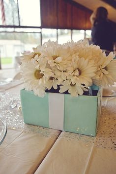 Bridal Brunch. Centerpieces. Breakfast at Tiffany's. Flower arrangement. Bride. Wedding. Bridal Shower. DIY. Decorations. Teal and White.