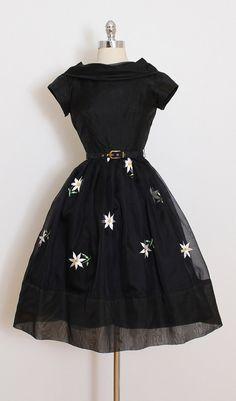 ➳ vintage 1950s dress * black organza * acetate lining * beautiful daisy embroidery * detachable belt * metal back zipper condition | excellent fits like xs length 40 bodice 14 bust 36 waist 25 ➳ shop http://www.etsy.com/shop/millstreetvintage?ref=si_shop ➳ shop policies http://www.etsy.com/shop/millstreetvintage/policy twitter | MillStVintage facebook | millstreetvintage instagram | millstreetvintage 5824/1628
