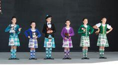 from left - male dancer in kilt Green Vest, Purple Jacket, Royal Blue Dresses, Purple Dress, Scottish Highland Dance, Dancers, Tartan, Turquoise, Costumes