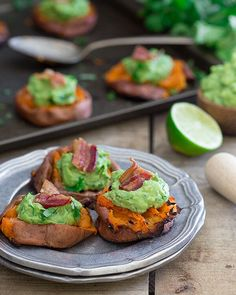 Smashed sweet potato guacamole bites topped with a crispy piece of salty bacon are the perfect bite.