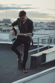 Men guitar singer fashion rooftop