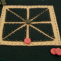 Craft project: Instructions and printable patterns for making an Achi game board using felt or paper. The project also includes rules for playing Achi and some history on this game from Ghana.
