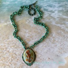 Beach Jewelry .. Seahorse Cab Necklace that is painted using alcohol inks and is mounted on a aqua bezel .. rhinestones are placed around the cab and down the side of the seahorse .. Chain is made with aqua 6mm wood beads .. FOR SALE ..https://www.facebook.com/JewelsByJann