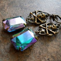 These unique one-of-a-kind earrings have a deep, dark secret. The lovely, authentic vintage rectangular glass jewels, sparkling with deep violet, emerald green, and aqua, are encased in antiqued brass settings and dangle from vintage brass filigree. If you look closer, a tiny skull and crossbones embellish each for real gothic chic. They measure just under 2 inches long and finish with antiqued brass victorian style lever back ear wires. Just stunning!    PLEASE be sure to read my shop…