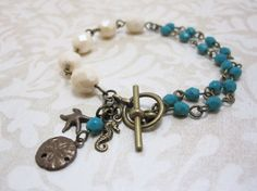 Beach Bracelet - Ivory and Turquoise Glass Beaded Starfish, Sand Dollar and Seahorse Bracelet $26