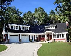 Cottage charm. Get the garage door look with Clopay Coachman Collection steel and composite carriage house doors, Design 12 with REC14 windows. Insulation is key since there is living space above. www.clopaydoor.com