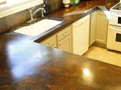 How to Make Concrete Counter Tops.I love the stain on these.Just beautiful.