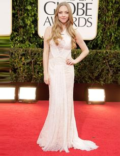 Amanda Seyfried in Givenchy at the Golden Globes 2013. Wish she wouldn't cover her dress with that wash-n-wear hair.