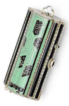 An Art Deco Compact, early/mid 20th century, in the manner of Cartier. Geometric design with wirework look detailing, highlighted with mint green and black enamel, inset with dark blue gemstones/glass to the clasps, stamped 'Sterling' to the interior and with no. 11, hallmarks to loop handle. #ArtDeco #vintage #compact