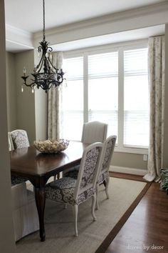Pleated treatments are mounted on a short board on each end of the window. Simple dining room drapes for framed windows Dining Room Drapes, Dining Room Windows, Dining Room Table, Drapes And Blinds, Drapery Panels, Drapes Curtains, Valances, Bow Window Treatments, Window Coverings