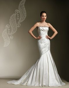 Beaded trim accents this strapless pleated silk dupion mermaid, buttons down back zipper, chapel length train.