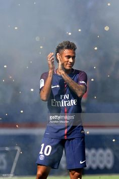Neymar of Paris Saint-Germain reacts as he is presented to the fans before the Ligue 1 match between Paris Saint-Germain and Amiens at Parc des Princes on August 5, 2017 in Paris, France.