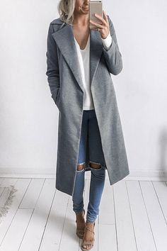 The coat features side pockets, long sleeves, which is classic style. You could wear it with a long sleeve top, a blue jeans and a pair of sneakers in winter. It can keep you warm and fashion.