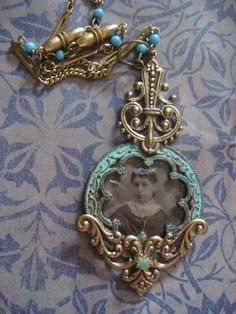 Necklace made from antique tintype and other old pieces of antique jewelry.
