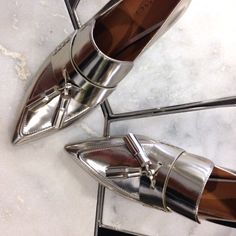 Coach metallic silver loafers
