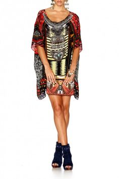 Camilla Warrior Short Round Neck Kaftan find it and other fashion trends. Online shopping for Camilla clothing. Boasting a hypnotic colour palette inspired...