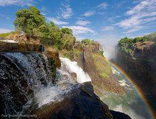 a rainbow, a waterfall