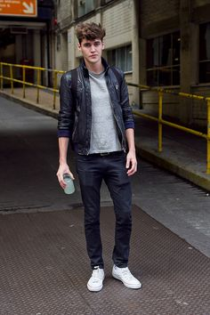 Coggles Fashion - London Street Style with grey t-shirt, leather jacket, dark wash denim jeans and white trainers. #streetsyle #fashion